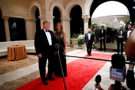 Melania Stuns In Sparkling Gold And Black Gown At New Year