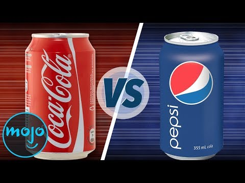 Bottles Of Carbonated Soft Drink Coca Cola And Pepsi
