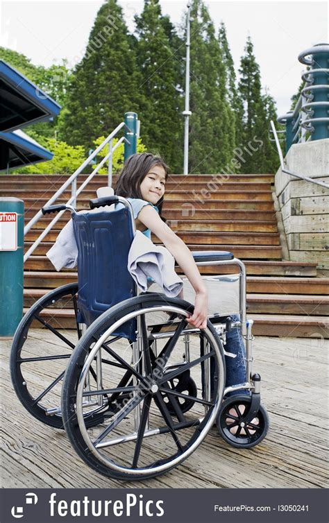 Photo Of Young Girl In Wheelchair In Front Of Stairs
